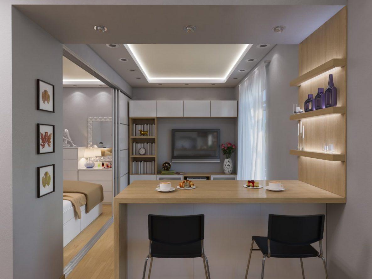 Meble Ikea, meble do mieszkania, meble do małego mieszkania, ikea szafy do przedpokoju, meble do małych mieszkań, meble do strefy wypoczynku, szafa do małych przestrzeni, jak umeblować mieszkanie, małe mieszkanie, projekt mieszkania, widok na salon, stołki barowe Stig przy podwyższonym blacie kuchennym, w tle szara ściana z telewizorem i regałem Besta, z lewej mała sypialnia z łóżkiem Brimnes, pod ściana komody Malm