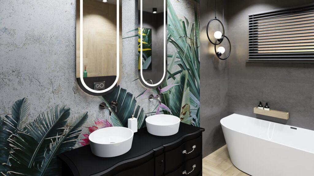 Projektowanie wnętrz cennik, łazienka w kolorach szarości, po lewej na ścianie tapeta z motywem dżungli, tapeta Wonderwall Studio Paradise, na wprost wanna przyścienna Rea Olimpnia, czarna stylizowana komoda, na komodzie dwie umywalki nablatowe i podświetlane lustra owalne, na ścianie po prawej betonowe panele LVT