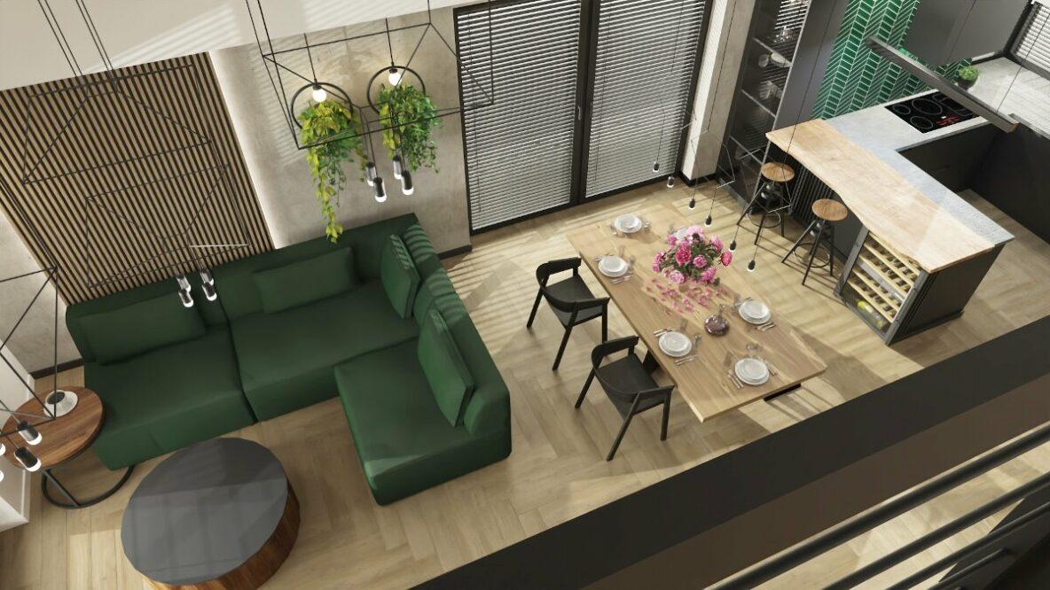 Projekt mieszkania cena, salon połączony z kuchnią i jadalnią, widok z góry z antresoli, zielona kanapa, drewniany stół czarne drewniane stołki przy stole, kuchnia z drewnianym barkiem blatem