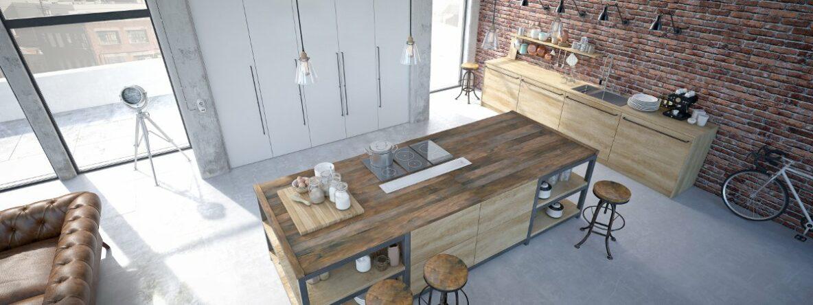 Dlaczego projektant wnętrz, Widok z góry na kuchnię z wyspą, drewniana wyspa kuchenna na metalowej konstrukcji, loftowa kuchnia, szafki kuchenne drewniane, ściana z czerwonej cegł, podłoga betonowa