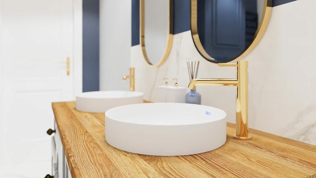 Łazienka z granatową ścianą, kafelki paradyż calacatta, złote baterie umywalkowe omnires, umywalka Roca, drewniany blat w łazience