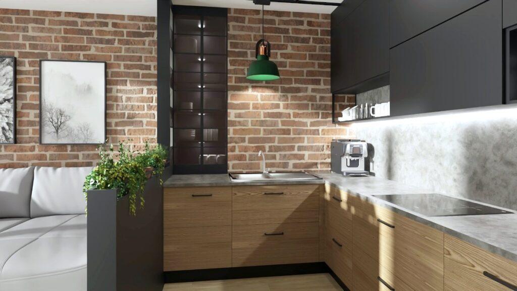 Małe mieszkanie projekt, kuchnia w kawalerce, kuchenne dolne szafli drewniane, górne szafki w kuchni grafitowe, kuchnia płyta Swiss Krono, zielona metalowa lampa nad blatem, szklana witryna we wnęce