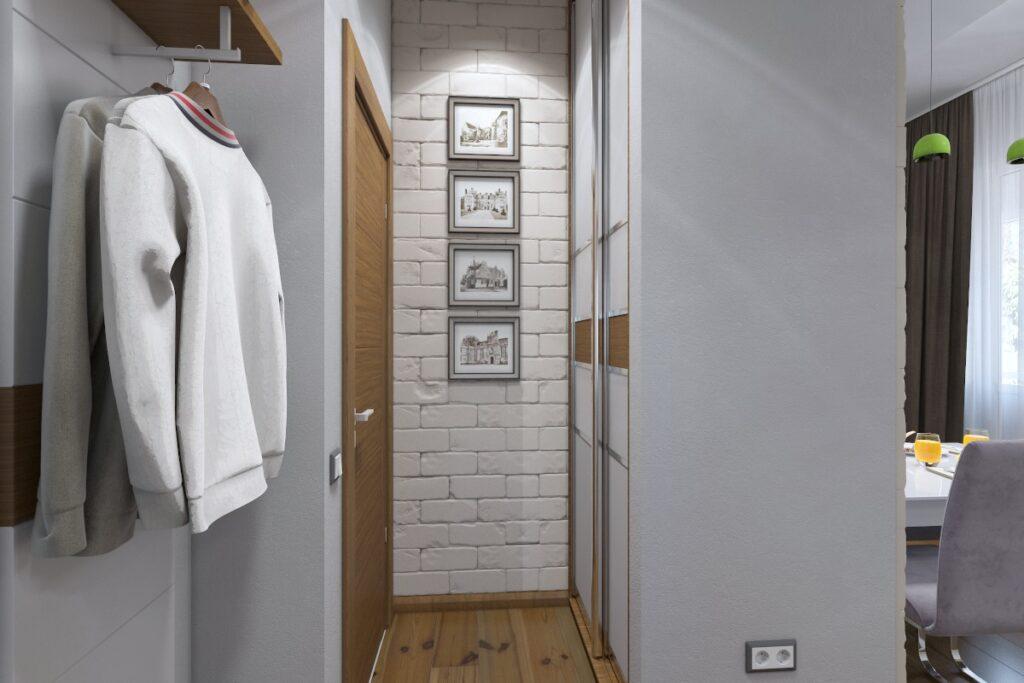 Projekt przedpokoju, szafa do przedpokoju, mały przedpokuj, szafa wnękowa po prawej, na wprost ściana z białej cegły, po lewej wieszak na ubrania