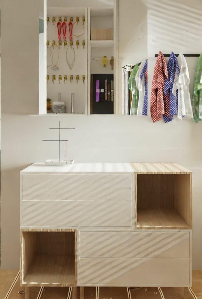 Projekt mieszkania w bloku mała komoda w garderobie- Warszawa